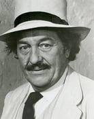 Strother Martin (Percy Garris)